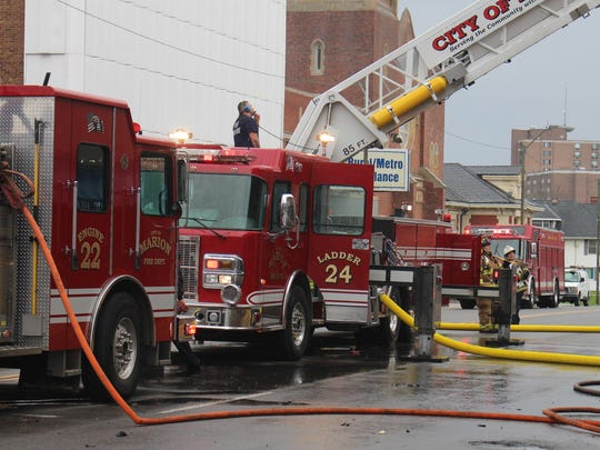 Parts of South Main and Church streets were closed for around an hour as firefighters battled a rooftop blaze at the public health building on Friday.