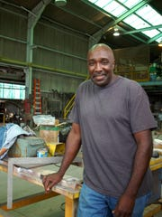 Lawrence Butler, who was the driving force behind the local Diversity Parade, is seen here at his business in 2008.