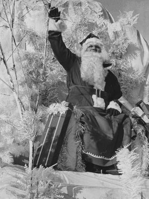 10,000 spectators braved the frigid temperatures to greet Santa Claus during the 1964 Christmas parade.