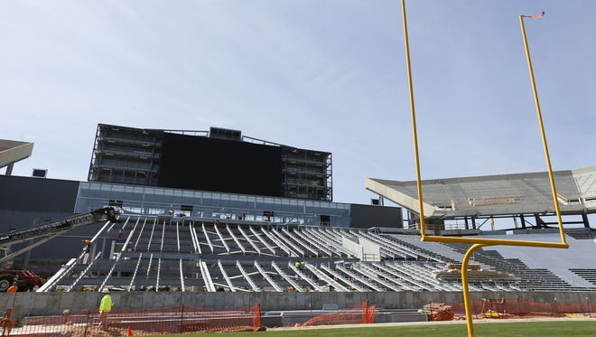 A giant big screen and bleachers are being installed on Wednesday in the south end zone at Jack Trice Stadium in Ames.