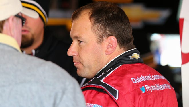 Sprint Cup Series driver Ryan Newman (31) looks on during practice for the STP 500 at Martinsville Speedway.
