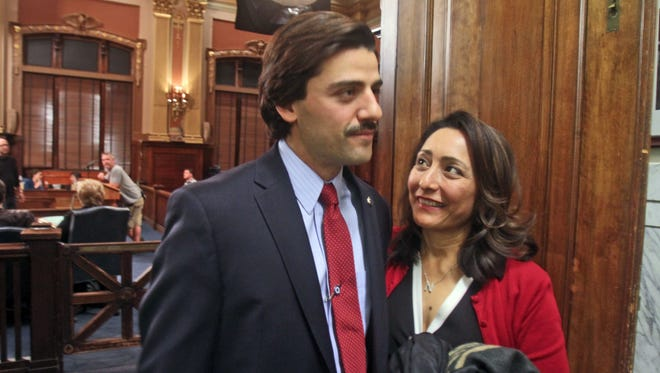 Actor Oscar Isaac, left, with Nay Wasicsko, the widow of former Yonkers Mayor Nicholas Wasicsko, at Yonkers City Hall during the 2014 filming of the HBO series 'Show Me A Hero.' Isaac portrayed Nick Wasicsko.