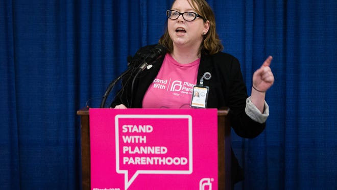Tamarri Wieder of Planned Parenthood addresses the crowd during a rally in support of Planned Parenthood at the Capitol Tuesday.