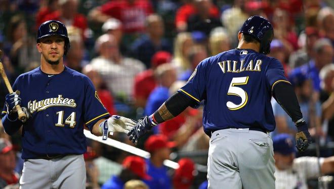 Hernan Perez  congratulates Jonathan Villar  after scoring a run in the fith inning.