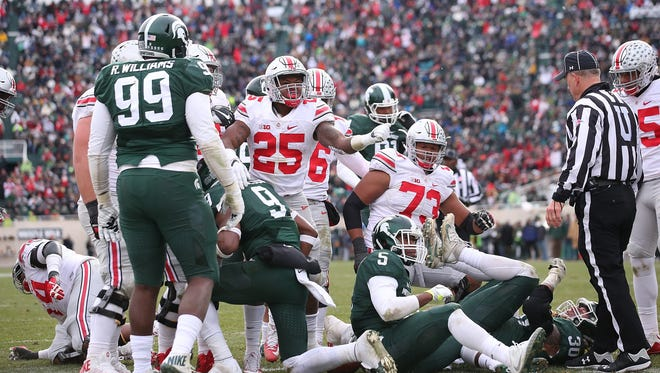 Ohio State running back Mike Weber scores the go-ahead touchdown in the third quarter of Michigan State's 17-16 loss on Nov. 19, 2016, in East Lansing.