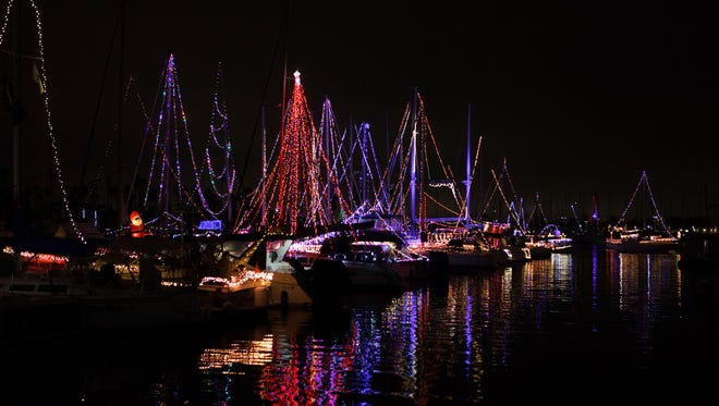 Boats decorated in Christmas lights are seen in the Channel Island Harbor for the 51st annual Parade of Lights held Saturday evening.