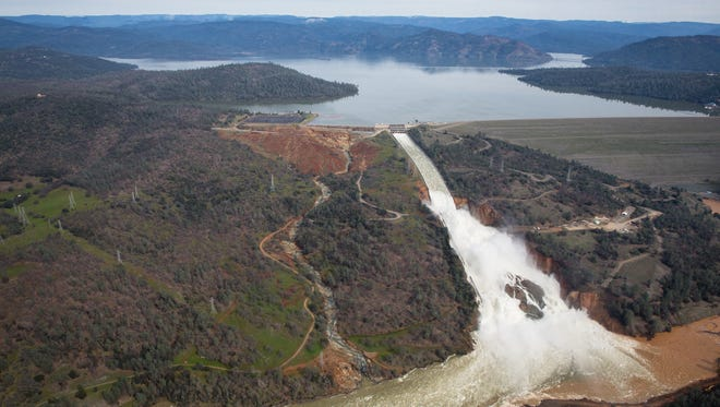 Oroville lake, the emergency spillway, and the damaged main spillway, are seen from the air on February 13, 2017 in Oroville, California. The erosion damage seen below the emergency spillway caused officials to issue evacuation orders to more than 188,000 people in downstream areas.