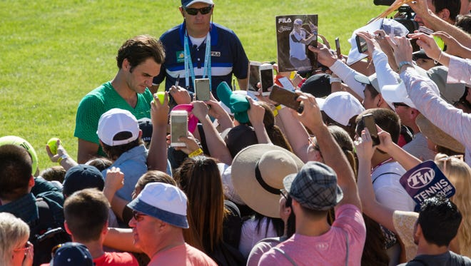 Roger Federer signs autographs for fans at the BNP Paribas Open in Indian Wells, Calif., Wednesday, March 8, 2017.