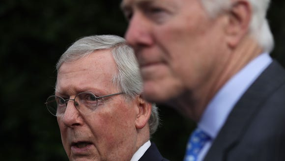 Senate Majority Leader Mitch McConnell, R-Ky., left,