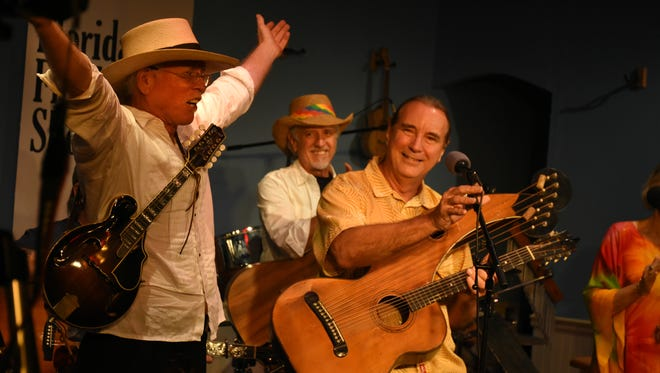 J.Robert Houghtaling, left, thanks headliner Andy Wahlberg at the show's finale. Marco musician JRobert hosted the Florida Songwriter Showcase, with a series of Sunshine State songwriters playing and singing their compositions on Monday evenings at the Marco Players Theater.