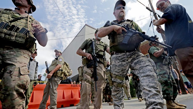 Some showed up heavily armed at the protest in Charlottesville on Aug. 12, 2017.