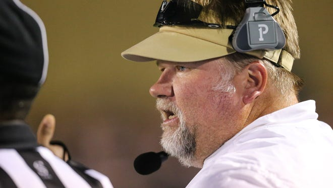 Pearl head football coach John Perry talks to an official. Pearl and Northwest Rankin played in an MHSAA Class 6A football game at Pearl on Friday, September 1, 2017.