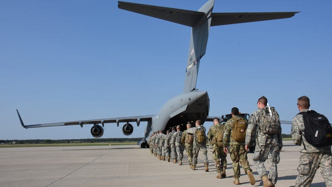 A group of 600 Wisconsin National Guard members board one of 10 military aircraft at Volk Field in 2017 for deployment to Florida for Hurricane Irma.