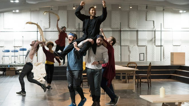 """Delaware actor Rory Donovan, in blue shirt and bandana, supports singer John Legend during a rehearsal of NBC's """"Jesus Christ Superstar,"""" which airs on Easter."""