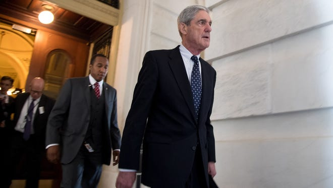 Former FBI Director Robert Mueller, front, the special counsel probing Russian interference in the 2016 U.S. election, leaves the Capitol building after meeting with the Senate Judiciary Committee on Capitol Hill on June 21, 2017 in Washington, D.C.