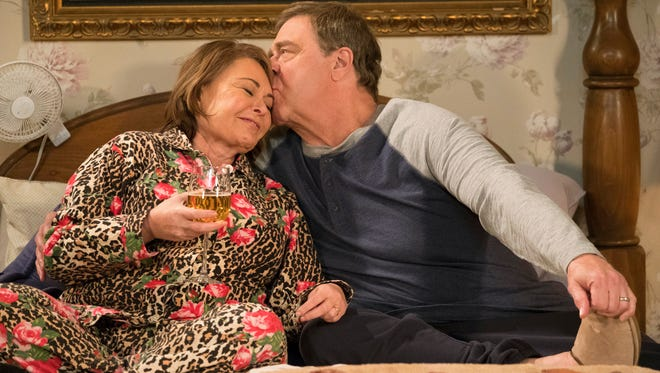 "In this image released by ABC, Roseanne Barr (left) and John Goodman appear in a scene from the season finale of ""Roseanne,"" which aired May 22."