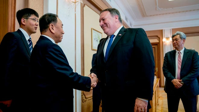 Secretary of State Mike Pompeo greets North Korea's director of the United Front Department, Kim Yong Chol as they arrive for a meeting at the Park Hwa Guest House in Pyongyang on July 6, 2018.