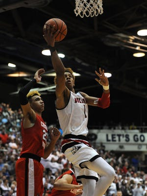 New Albany's Romeo Langford (right) shoots against Center Grove's Trayce Jackson-Davis (left) on Saturday during the Regional Final at Seymour High School. March 10, 2018.