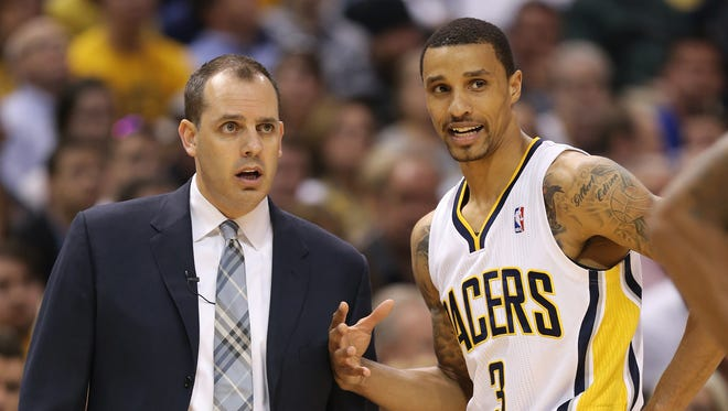 Indiana coach Frank Vogel and player George Hill talk on the sideline in the second quarter as the Indiana Pacers hosted the Atlanta Hawks in Game 2 of the Eastern Conference First Round at Bankers Life Fieldhouse Tuesday April 22, 2014.