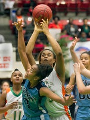 FAMU High School's Dominique Jeffery (35) goes up for a basket over Covenant Christian School's Alexis Gordon (3) during the first half of their FHSAA Girls 2-A Semifinal game at The Lakeland Center Tuesday. FAMU won the game 76-55. February 16, 2016 MICHAEL WILSON/THE LEDGER