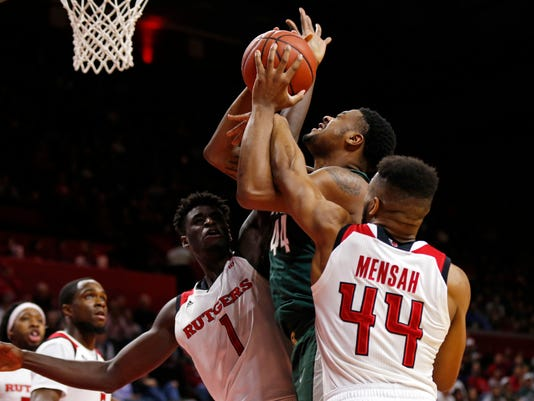 Michigan State forward Nick Ward is fouled by Rutgers guard Souf Mensah (44) in front of Rutgers forward Candido Sa (1) during the first half of an NCAA college basketball game, Tuesday, Dec. 5, 2017, in Piscataway, N.J. (AP Photo/Adam Hunger)