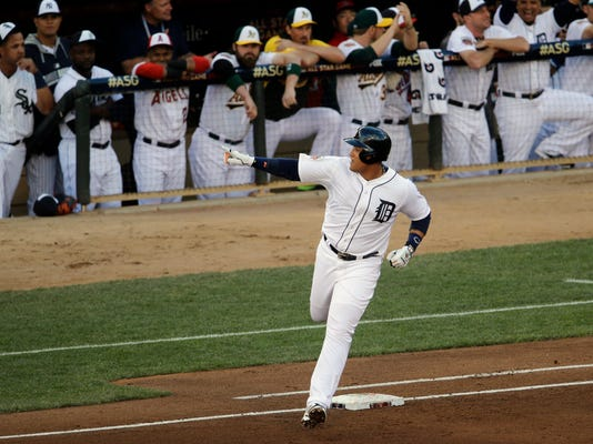 American League first baseman Miguel Cabrera, of the Detroit Tigers, hits a home run  during the first inning of the MLB All-Star baseball game, Tuesday, July 15, 2014, in Minneapolis. (AP Photo/Paul Sancya)