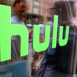 The Hulu logo adorns a window at Milk Studios in New York. The cable network Epix has landed a multiyear, digital subscription video-on-demand deal with the streaming service.