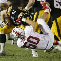 The goal this season for Iowa quarterback C.J. Beathard is to get down before an opposing defender can try to take his head off, as in this photo from the Rose Bowl.