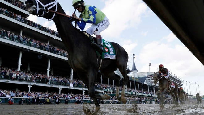 Jockey John Velazquez rides Always Dreaming to victory in the 143rd running of the Kentucky Derby on Saturday.