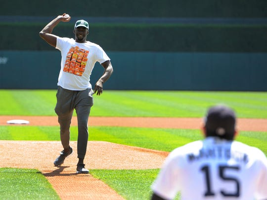 Golden State Warriors' Draymond Green throws the first pitch to Tigers' Mikie Mahtook prior to a baseball game against the White Sox on Thursday, Sept. 14, 2017 at Comerica Park in Detroit.