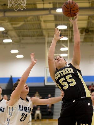 Southern Regional's Shauna McHale goes up with shot as she's guarded by Toms River East's Kamryn Lister. Southern Regional Girls Basketball vs Toms River East in Toms River on February 4, 2016