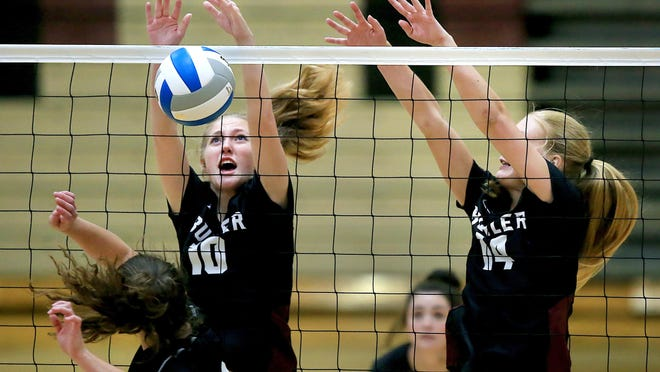 Buhler's Rae Groth (10) and Maddie Holland (14) block the ball against Rose Hill during their game Tuesday. Buhler defeated Rose Hill 25-13, 25-19.