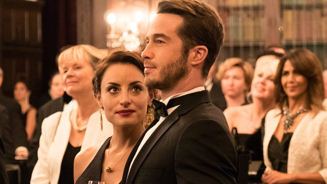"Valentina (Marimar Vega) and Jason (Ryan Carnes) are engaged in ""La Boda de Valentina."""