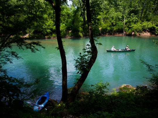 Two paddlers float down the scenic Eleven Point River on Thursday, June 7, 2018. The river 2.5 hours east of Springfield is spring fed and floatable year round.