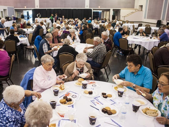Volunteers eat at The Retired and Senior Volunteer Program's recognition lunch Monday. More than 200 senior volunteers gave more than 25,000 hours in 2015.