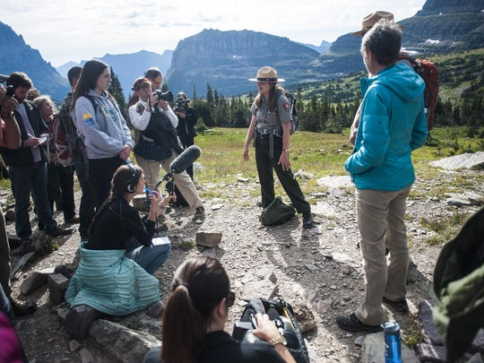 Teagan Tomlin, interpretive park ranger, speaks on using Glacier as a classroom to connect with future generations during Secretary of the Interior Sally Jewell's centennial national parks tour in Glacier on Thursday.
