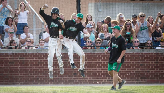Yorktown's Luke Hill, left, celebrates a run during the IHSAA Class 3A Baseball Sectional Championship on May 8 at Yorktown High School. Yorktown won with a final score of 2-0 against Guerin Catholic which puts them in the Bellmont Regional next weekend.