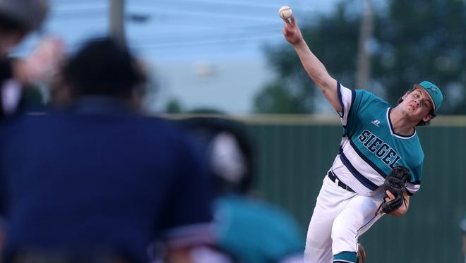 Siegel's John Ross Langworthy delivers a pitch during Tuesday's District 7-AAA baseball championship.