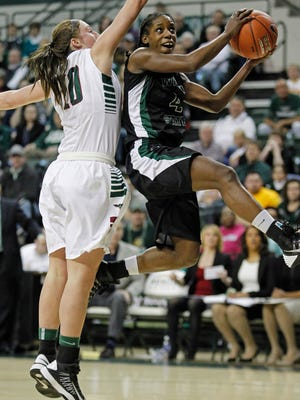Wright State's Kim Demmings shoots against UW-Green Bay forward Mehryn Kraker during the Horizon League tournament championship  game last March. Demmings is out for the season with a broken foot.