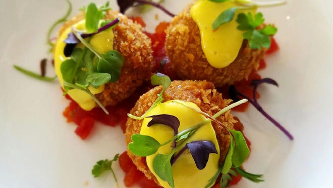 Arancini with porcini mushrooms, asiago, tomato jam and saffron aioli at Stella in Phoenix.