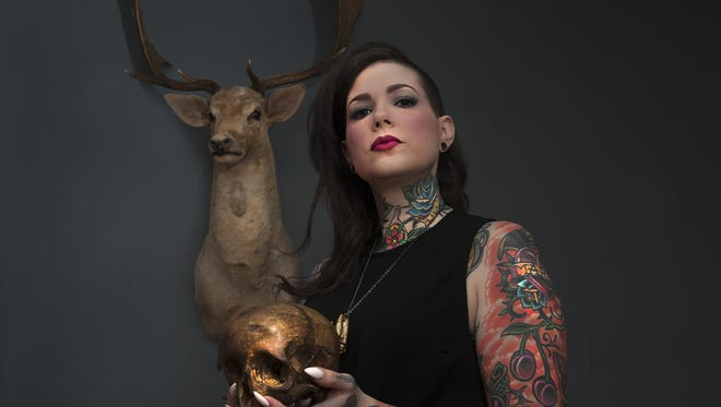 Nicole Angemi poses for a photo holding a human skull at her home in Merchanville. Angel, is an Instagram star: More than 800,000 followers see her photos from autopsies, medical exams and emergencies. The Merchantville woman, a pathologist's assistant, is hoping to educate followers on health, death and anatomy.