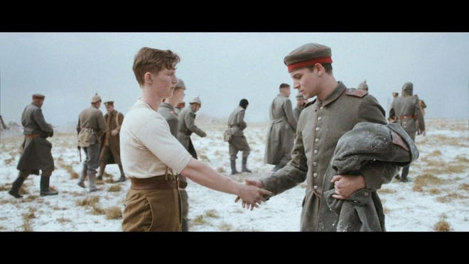 In this handout still image of a television advertisement, an actor dressed as a German WWI soldier, right, and an actor dressed as a British WWI soldier left, shake hands.