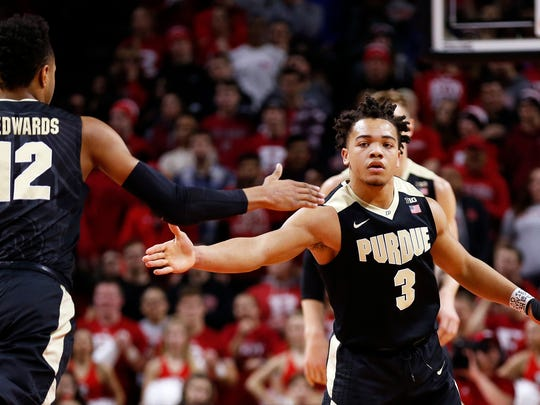 Purdue guard Carsen Edwards (3) celebrates with Purdue forward Vincent Edwards against Rutgers during the first half of an NCAA college basketball game Saturday, Feb. 3, 2018, in Piscataway, N.J. (AP Photo/Adam Hunger)