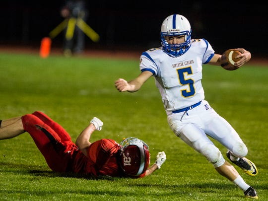 Northern Lebanon's Stevie Herb shakes Annville-Cleona's Gavin Stoudt for a few of his 162 rushing yards on Friday night.