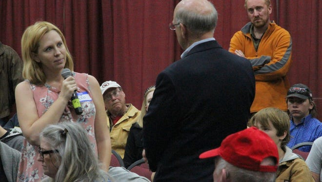 Congressman Steve Pearce listens to Otero County Indivisible founder Carrie Ludington asking him a question during Pearce's Ruidoso town hall meeting Saturday.