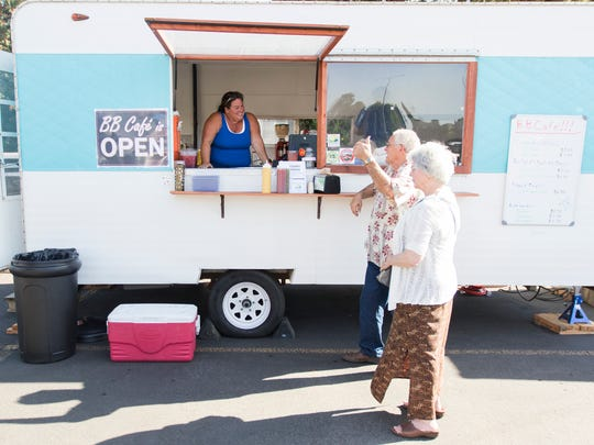 Ginger Murphy talks to customers at a soft opening for the BB Cafe food truck on Friday, Aug. 5, 2016. Murphy, the truck's owner, is reopening the Blueberry Cafe in food truck form after the original restaurant was closed in 2002.