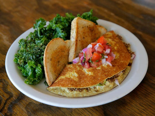 At Seed to Sprout, the Mexican omelet is made with tofu and cashew in place of eggs and filled with sunflower taco meat, pico de gallo, avocado and cashew cheese.