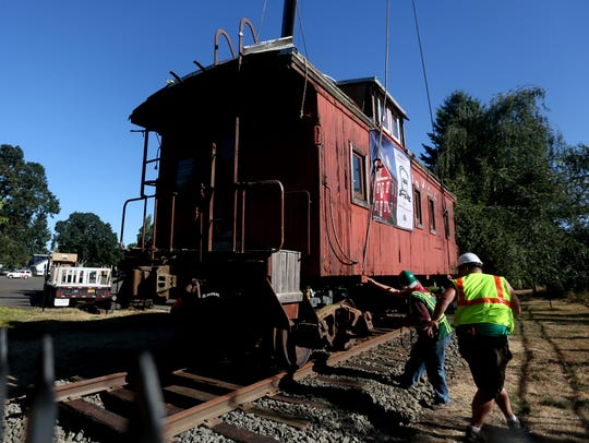 Caboose #507, built in 1913, is placed outside the