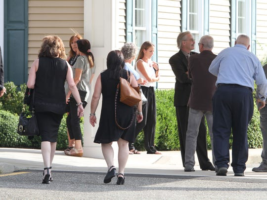 People arrives for the wake and funeral service for Kim Dunphey and her son Owen Scott at the Quinn-Hopping Funeral Home in Toms River Wednesday, August 23, 2107.  They were murdered in Lacey Township by her husband, who also killed himself.