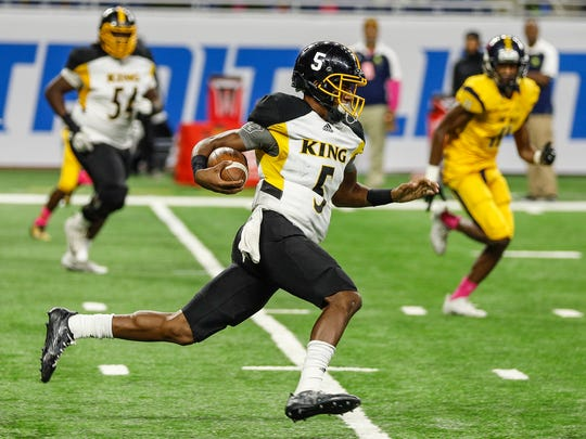 Detroit King quarterback Dequan Finn runs with the football against East English Village during the Detroit Public School League championship game at Ford Field, Friday, Oct. 20, 2017.